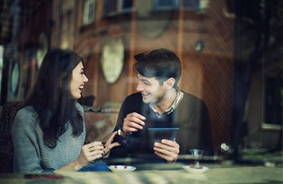 A woman and man smiling to each other at a cafe in Istanbul, Turkey