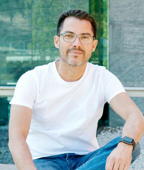 Nestor Gonzalez, Managing Director in casual attire sitting outside Mindcurv S.L. office in Alcobendas, Spain