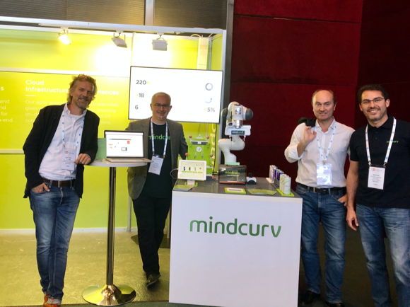 Mindcurv Members gathering around Panda showcase table at Mindcurv's booth prior the B2B Online 2019 event